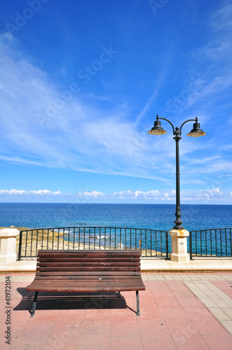 Bench at the seafront - 61972104