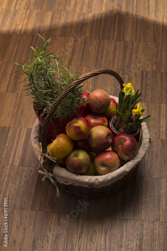 Basket Filled With Apples And Rosemary