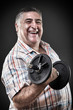 Happy fat man with dumbbell