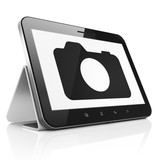 Vacation concept: Photo Camera on tablet pc computer