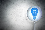Business concept: Light Bulb with optical glass on digital