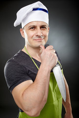 Attractive man cook holding a sharp knife