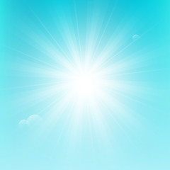 Shiny sun on blue sky background