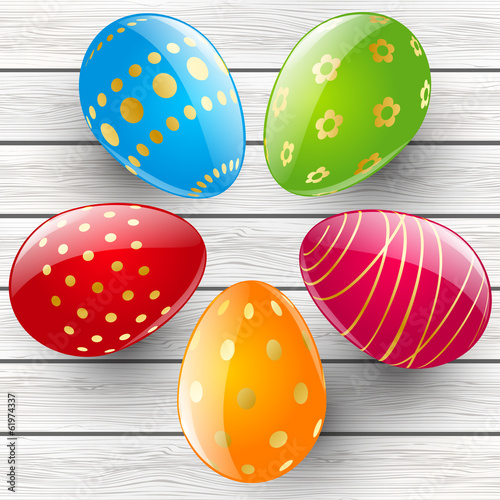 Color Easter eggs on wooden background