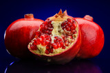 red pomegranate fruits on dark blue background
