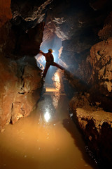 Silhouette of a cave explorer in the underground