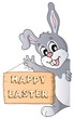 Happy Easter sign and lurking bunny