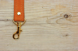leather strap with carabiner on a wooden board