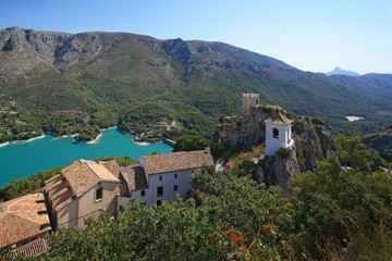 Guadalest lake and village. Reservoir and tiled roofs.