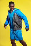 Athletic black man in sportswear fashion. Runner with jacket. In