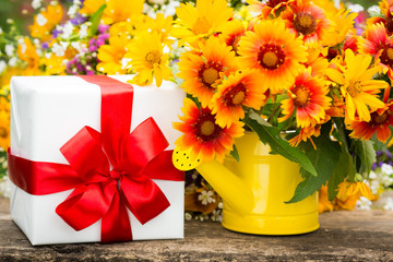 Gift box and spring flowers