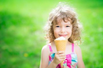Happy child eating ice cream
