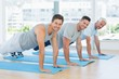 canvas print picture - Fit men doing push ups at gym