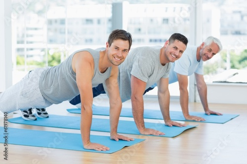 canvas print picture Fit men doing push ups at gym