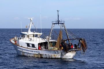 Trawler fishing boat raising nets