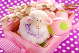 easter basket with eggs and sheep figurine