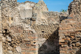 Broken stone and brick walls in Pompeii