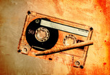 grunge cassette tape and pencil