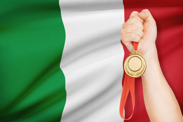 Medal in hand with flag on background - Italy