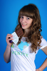 pretty girl posing in studio on a blue background