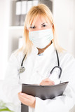 Woman doctor with stethoscope and surgical mask