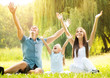 canvas print picture - Happy smiling family in the park