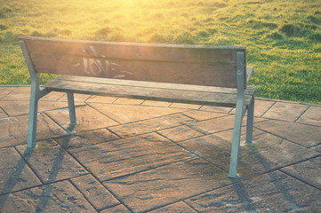 wooden bench with sun rays and vintage effect