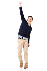 Excited Asian young man