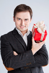 man holding a gift near the face, sexy look