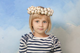 Little girl with Ukrainian traditional wattled garlic round