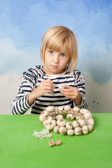 Little pretty girl peeling garlic