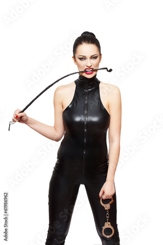 Sexy dominatrix with whip and handcuffs