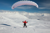 Paraglider in winter Caucasus mountains in Georgia