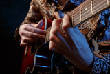 Fototapety Guitarist playing an acoustic guitar