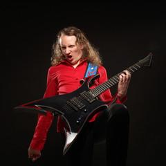 Rock guitarist plays solo guitar