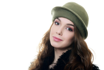 The young beautiful woman in an autumn beret on a head
