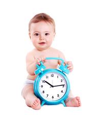 Baby boy holding the big blue alarm clock