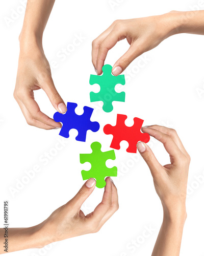 Red and blue puzzle in woman hands isolated on white