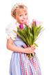 kleines Mädchen im Dirndl mit Tulpen