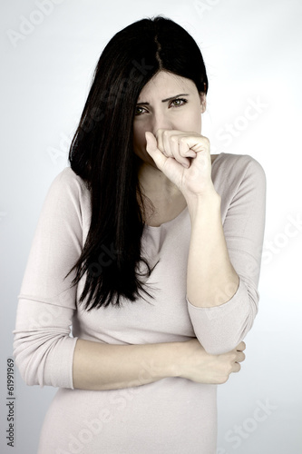 Woman feeling sick coughing and holding mouth and stomach