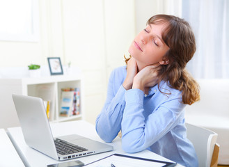 Portrait of young smiling business woman relaxing at work