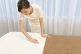 aesthetician preparing bed poster
