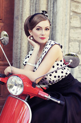 A sexy woman near a red retro scooter