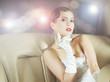 A beautiful celebrity woman sitting in a luxury car
