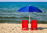 Beach chairs with parasol
