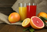 Lots ripe citrus with juice on wooden background