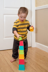 Down Syndrome child playing with stacking toy