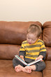 Down Syndrome child reading a book