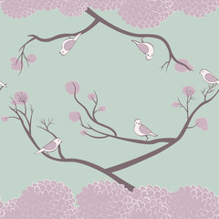 Birds sitting on tree branches seamless pattern