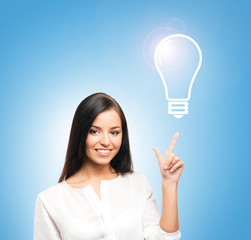 A successful and beautiful businesswoman with a bulb
